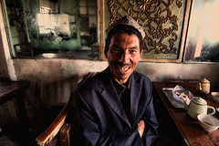 kashgar~ at the old teahouse (~mimo~) Tags: china portrait man color film smile movie photography xinjiang kashgar uyghur teahouse moslem kiterunner mimokhair mimokhairphotography