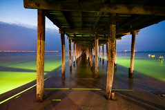 under the pier (Sky Noir) Tags: ocean summer people usa beach fun photography lights evening bay virginia pier us twilight fishing dusk unitedstatesofamerica shoreline surreal shore vabeach late bluehour chesapeake crabing glowstickgreen skynoir