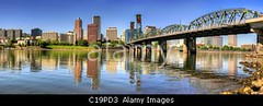 C19PD3 (Clay Myers) Tags: city morning travel bridge blue trees sky panorama reflection skyline oregon marina river portland landscape rocks downtown cityscape waterfront skyscrapers esplanade hawthorne banks willamette