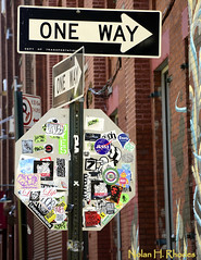 Only one way!!!!  Which Way???? (nrhodesphotos(the_eye_of_the_moment)) Tags: windows signs building brick metal graffiti wiring gates pipe bracket shapes pole arrows oneway decals octagon departmentoftransportation eightsided nrhodesphotosyahoocom wwwflickrcomphotostheeyeofthemoment dsc0819nhr
