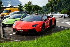 Ferrari Classic meets Lamborghini aggression (aguswiss1) Tags: ferrarilamborghini ferrari 575m 575 maranello lamborghini aventador gallardo superleggero italien italiensupercar supercar sportscar millionaire racecar racer cruiser worldcar red green silver parked orange lp570 lp700