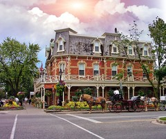 Niagara on The Lake ~ Ontario ~ Canada  ~ Prince of Wales Hotel ~ Heritage (Onasill ~ Bill Badzo) Tags: niagaraonthelake princeofwales princewales style victorian architecture boutiques corner downtown historic heritage lobby furniture mustsee attractionsite onasill mansard outdoor building road sunset clouds sky ontario ont canada niagarafalls