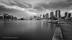 Victoria Harbour, Docklands, Melbourne (trevorjphotography) Tags: victoriaharbour docklands cbd melbourne australia longexposure le smoothwater blurrywater icywater canoneos5dmarkii ef1740mmf4lusm ndfilter neutraldensity fotga wideangle buildings etihadstadium marina boats docks streakyclouds