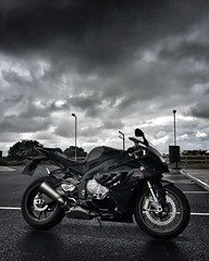 Waiting for rain to pass (phil_male) Tags: cloudysky bmw motorbike s1000rr