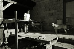 It is always something to fix or to improve... (Zsofia Nagy) Tags: flickrlounge saturdaytheme blackwhite blackandwhite bw dog family house work workingman zsemle