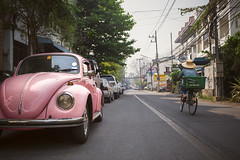 Pinky (tylerkingphotography) Tags: chiangmai thailand city thai outdoor photography nikon d3100 travel backpacking photographer amateur traveling explore 1855mm southeastasia car pink traffic street biker volkswagen road vehicle