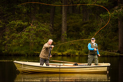 great cast (grahamrobb888) Tags: nikond800 sigma120400mm angling fishing flyfishingtroutfishing boat balhomishloch scotland perthshire forest water trees reflection