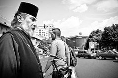 A Conservative Life in a Liberal World (stimpsonjake) Tags: nikoncoolpixa 185mm streetphotography bucharest romania city candid blackandwhite bw monochrome orthodoxy priest hat liberal conservative religion kamilavka