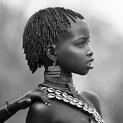 Hamer girl during bull jumping ceremony, Turmi, omo valley, Ethiopia (Eric Lafforgue) Tags: africa portrait people blackandwhite haircut girl childhood horizontal hair outside outdoors photography cow necklace beads kid day child hand friendship profile ceremony culture shell tribal bull celebration innocence bead omovalley tradition ethiopia tribe ethnic hairstyle rite hamar perle oneperson traditionalculture hornofafrica ethnology headandshoulders omo eastafrica braidedhair traditionalclothing realpeople 8201 waistup cauri turmi africanethnicity pastoralist bullleaping snnpr onechildonly bulljumping southernnationsnationalitiesandpeoplesregion hamerbenaworeda ethiopianethnicity onekidonly onelittlegirlonly