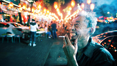 Ghost Street (Jonathan Kos-Read) Tags: china smile night crazy cool beijing oldman smoking lanterns  uncool  smoker manic  guijie chineselanterns crazysmile  cool2  sigma20mmf18exdg ghoststreet cool5 cool3 cool6 cool4  savedbythedeltemeuncensoredgrou  cool7 uncool2 iceboxcool