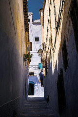 Chefchaouen - Street - 2 (aminefassi) Tags: world life africa street city travel blue light shadow copyright color wall architecture lumix stair ombre arabic panasonic bleu morocco lumiere maroc atlas medina chaouen chefchaouen chefchauen marokko dmc 2012 rif photographe chauen archit m43 mft xauen morokko gx1 microfourthirds 20mmf17 dmcgx1 aminefassi xexauen
