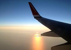 At 10 000 feet (Dencku) Tags: sunset sun sol clouds plane airplane flying flight wing norwegian airliner 4s iphone solnedgng flygplan moln aurinko pilvi lentokone flyga vinge lent norwegianairshuttle siipi aurinkolasku norwegianno