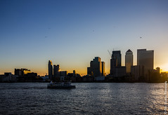 Warm Light @ London Docklands. [Explored + Front Page!] (Ollie Smalley Photography  Travelling) Tags: blue light summer sky seagulls london water glass birds ferry thames skyline canon buildings reflections river lens evening boat construction warm shadows skyscrapers warmth sigma wideangle massive reflective docklands 1020mm ultra offices starburst shimmer 550d olliesmalleyphotography