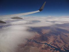 Leavin' on a jet plane... (RobertCross1 (off and on)) Tags: window clouds river airplane utah wing jet bluesky canyon