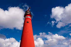 lighthouse in the sky (Jos Mecklenfeld) Tags: blue sky lighthouse clouds island wadden northsea ricoh vuurtoren schiermonnikoog gx200 noordertoren ricohgx200