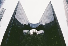 PwC, London (Nathan O'Nions) Tags: old sky black building tree london film glass price architecture skyscraper canon vintage lens big angle ae1 squares circles 28mm wide angles style wideangle iso business glossy architect 200 program huge gloss tall shape coopers negatives waterhouse businesses accounting pwc pricewaterhousecoopers londonbuildings londonbusiness