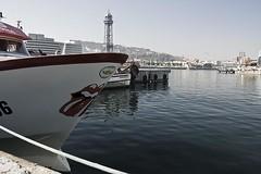 Moll del Rellotge (Pere Nubiola) Tags: barcelona sea tower water del logo boat stones sigma desaturated catalunya mm 1770 rolling moll jaume rellotge i