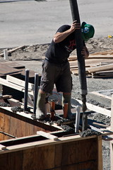 Pouring a Foundation 2 (LongInt57) Tags: houses hardhat people brown house canada man motion blur building men work buildings concrete person grey workers construction bc employment jobs okanagan helmet gray cement working boom valley forms worker form job hardhats helmets booms