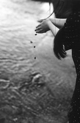 (Joshua Foster) Tags: sea bw film beach water girl canon hair hands rocks ae1 400 ripples canonae1 rockpools bethaney quietmomentslikethese