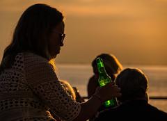 Cheers (Maria Eklind) Tags: sunlight sunset nature city vstrahamnen trdcket sun summer flaska siluett malm boardwalk sweden vatten sundspromenaden solnedgng goodnightsun silhouette europe sky bottle skneln sverige se