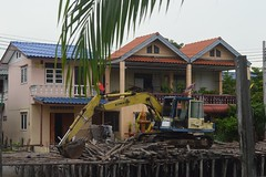 a front loader in the front yard (the foreign photographer - ) Tags: front loader house logs khlong lard phrao bangkhen bangkok thailand nikon d3200