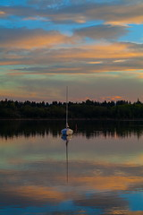 Moored (stevenbulman44) Tags: sailboat canon reservoir calgary summer landscape color pink blue sky polarizer 70200f28l lseries 5dmarkii water reflection tripod gitzo