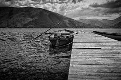 Holes In The Pier And A Great View (Alfred Grupstra Photography (bussy until 30 octobe) Tags: boat lakeprespa clouds lake mountains pier pustec qarkuikors albani al