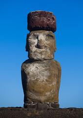 Monolithic Moai Statue At Ahu Tongariki, Easter Island, Chile (Eric Lafforgue) Tags: chile travel sky sculpture color colour history archaeology latinamerica southamerica nature statue rock vertical stone mystery outdoors photography polynesia ancient order exterior pacific guard fulllength bluesky nobody nopeople worldheritagesite majestic moai easterisland isolated colorphoto rapanui isladepascua hangaroa ahutongariki archeologicalsite humanhead southpacificocean traveldestinations largegroupofobjects placeofinterest oldruin internationallandmark ancientcivilisation 0851 polynesianculture malelikeness humanrepresentation builtstructure polynesianisland southamericanculture moaistatues southeasternpacificocean polynesiantriangle chileanpolynesia redscoriaheaddress