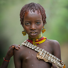 Hamer girl during bull jumping ceremony, Turmi, omo valley, Ethiopia (Eric Lafforgue) Tags: africa portrait people haircut color girl childhood hair square outside outdoors photography cow necklace beads kid day child friendship ceremony culture shell tribal bull celebration innocence bead omovalley tradition ethiopia tribe ethnic hairstyle rite hamar perle oneperson confidence traditionalculture hornofafrica ethnology headandshoulders omo eastafrica braidedhair traditionalclothing realpeople colorimage lookingatcamera 8204 waistup cauri redochre turmi africanethnicity pastoralist bullleaping snnpr onechildonly bulljumping southernnationsnationalitiesandpeoplesregion hamerbenaworeda ethiopianethnicity onekidonly onelittlegirlonly