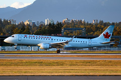 Air Canada | Embraer ERJ-190 | C-FGLW (Patrick Lundgren) Tags: travel blue sunset sea sky canada ice vancouver clouds plane canon airplane island photography fly flying leaf maple airport all colours air tail transport flight wing jet engine sigma gear columbia os richmond landing international e transportation airline british passenger 28 winglet yvr f28 types airliner rudder 190 embraer jetliner cyvr e190 120300 60d