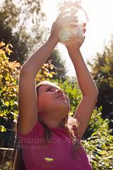 Catch the sun (2) ( Angel of light ) Tags: light sunlight girl child flare jar catch rays backlit angeloflight2009