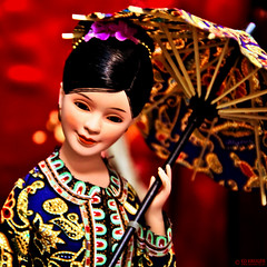 Singapore Doll (Ed Kruger) Tags: china red umbrella souvenirs singapore asia southeastasia doll asians chinese may allrightsreserved asianmarket 2011 peopleofasia asiancities earthasia may2011 edkruger 48p asiancountries cultureofasia photosofasia kirillkruger rodkruger