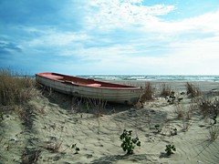 lost... ((rino)) Tags: sea sky beach water clouds lost boat photo sand flickr waves rino