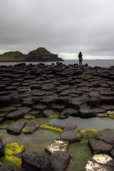 giant causeway and lonely girl (mariusz kluzniak) Tags: ireland portrait woman green girl giant person rocks europe moody view cloudy britain sony great north sigma single lonely alpha 1020mm northern wes causeway 580 a580