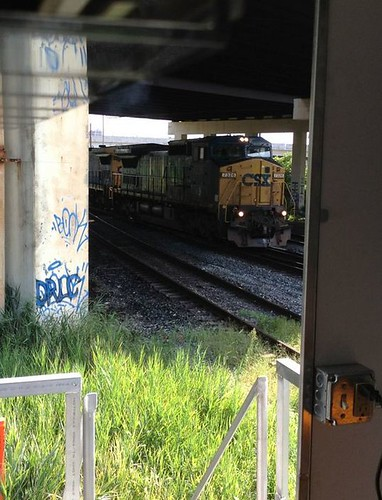 CSX Train Engine under an overpass