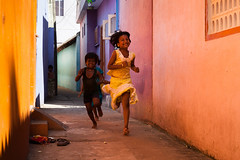 Run, Mamallapuram (Marji Lang) Tags: life street travel pink girls light people orange india playing motion color cute colors girl beautiful childhood yellow kids composition children fun happy moving movement colorful colours shadows play purple action lumire couleurs candid indian joy happiness running streetscene run ombre angels innocence enfants colourful moment lovely joyful tones bonheur tamil joie tamilnadu palette mahabalipuram mamallapuram decisive streetshot enfance tamoul travelphotography courir republicofindia insouciance ef247028l indiansubcontinent canoneos5dmarkii lumire travelanddocumentaryphotography marjilang