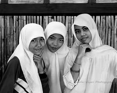 Three Girls in Black and White (hazy jenius) Tags: travel portrait woman girl indonesia asia sailing muslim islam hijab adventure tropical hayes hazy kampung bugis sumbawa jenius wera jilbab seatrek ombakputih jenniferhayes flowersofislam