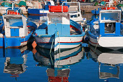 Favignana (vanto5) Tags: travel blue sea italy beach water colors reflections boat europe italia mare sicily fishingboat canoneos350d riflessi favignana reflexiones reflexes isoleegadi canonef24105mmf4lisusm rflexions mygearandme