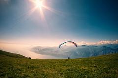 Paraglider at Monte Baldo, Lake Garda (manuelwieler) Tags: garda lakegarda lagodigarda montebaldo paraglider paragliding parachute mountainview landscape sunburst sun italy travel