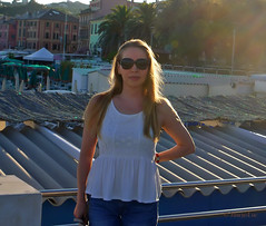 Holiday Golden Hour ... (MargoLuc) Tags: holiday summer time me golden light backlight hour sunset sea liguria walk relax girl woman jeans white top blond hair red lips sunglasses evening italy outdoor