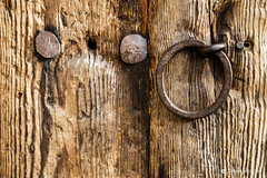 Old rustic wooden door with a ring handle (Simeon Donov) Tags: лещен селолещен туризъм родопи западниродопи aged architecture background building bulgaria bulgarian cast closeup construction copy corrosion country craft door entrance exterior frame full handle iron leshten metal nails old outside panel planks pull retro ring rough rural rustic rusty space studs surface texture timber tradition traditional vintage weathered weatherworn wood wooden woodgrain