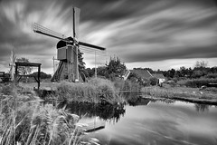 Beyond time (Sizun Eye) Tags: holland mill windmill molen moulin moulinvent wiatrak netherlands paysbas clouds nuages le longexposure poselongue leefilters lee bigstopper 10steps canal water wipmolen neederlands holandia polder sizuneye sizun mono monochrome noirblanc bw blackwhite nikond750 d750 tamron2470mmf28 tamron 2470mm