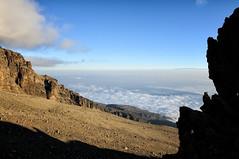 Above the clouds at Arrow Glacier camp - Kilimanjaro National Park - Tanzania (PascalBo) Tags: nikon d300 tanzania tanzanie africa afrique eastafrica afriquedelest kilimanjaro kilimandjaro kilimanjaronationalpark parcnationaldukilimandjaro lemosho hike hiking trek trekking outdoor outdoors volcanic rock stone clouds nuages sky ciel pascalboegli