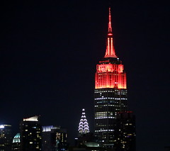The Empire State Building is lit red in honor of the Fifth Annual Women's Health RUN 10 FEED 10. (apardavila) Tags: chryslerbuilding empirestatebuilding hoboken manhattan newyorkcity nyc skyline skyscraper