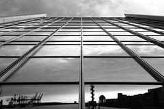 Docklands Lineflection mono (frank_w_aus_l) Tags: hamburg monochrome people hafen port nikon architecture bw noiretblanc lines docklands spiegelung perspective mirror deutschland de d7000