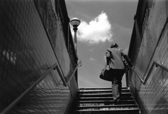 Ascent (The Frotographer) Tags: show newyorkcity light blackandwhite newyork love portraits project subway words community shadows power faces emotion happiness naturallight trains thoughts 35mmfilm rush commute exit commune entry levels brash nikonf5 ominence