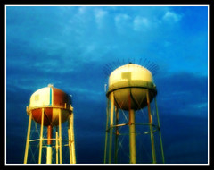 Painting on the water towers... (T.J. (Tanya Jo)- Back again) Tags: blue storm nature weather clouds watertower iphone