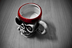 330/365. I Be A Scurvy Pirate. (Anant N S) Tags: wood red blackandwhite bw india texture blackwhite funny grain sharp pirate mug coffeemug pune selectivecolor project365 piratelanguage lensor anantns thelensor piratescull anantnathsharma pirateskullcoffeemug