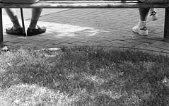 .......... (Time Share) Tags: city people urban blackandwhite bw ontario canada blancoynegro film monochrome analog 35mm walking blackwhite walk citylife streetphotography streetlife hc110 olympus canadian urbanexploration hp5 exploration zuiko olympusom2sp selfdeveloped filmphotography ilovefilm om2sp hc110b canadianeh autaut streetsoftoronto torontostreetphotography zuikoautot100mmf28 hp5400hc110b55min