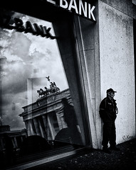 bank; a reflection (Collin Key) Tags: bw reflection berlin germany guard bank snap brandenburgertor quadriga deu allegorie financialcrisis collinkey